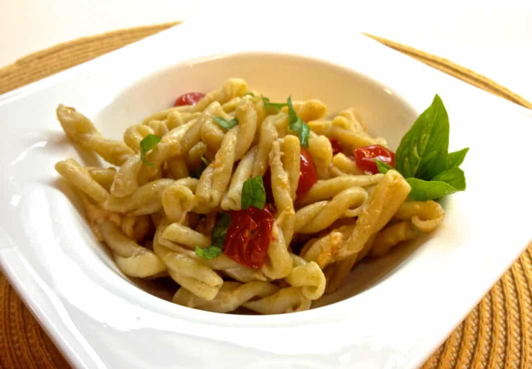 A square bowl of Gemelli Pasta with Tomatoes, Basil and Garlic
