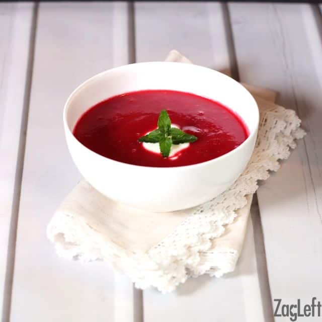 Borscht recipe for hearty and flavorful Russian soup that gets it's gorgeous color from fresh roasted beets. A classic beet soup recipe. | ZagLeft